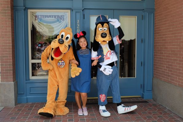 Joy with Pluto and Goofy