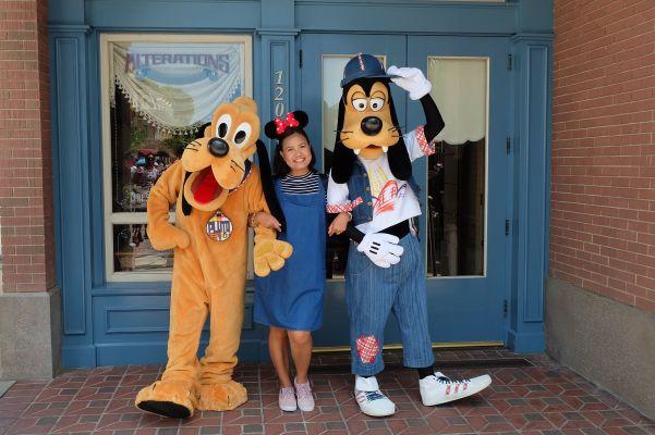 Joy with Pluto and Goofy
